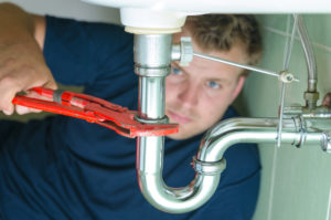 Plumber fixing leak in Yonkers